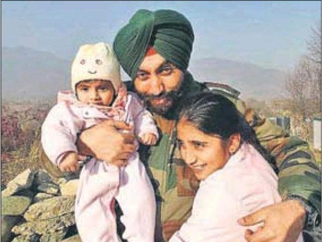 Lt Col Karanbir Singh Natt with his family.