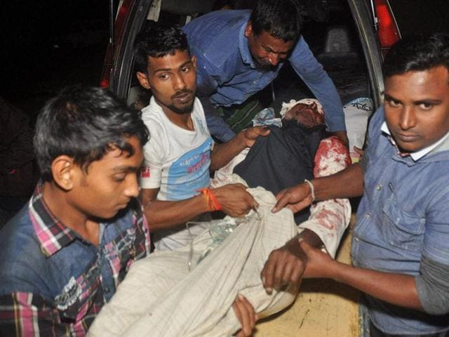 A man injured in an attack on a Shiite mosque is carried for treatment in Bogra district, Bangladesh. Dhaka's refusal to believe that Islamic State has set up shop in the country has been called into question in the latest deadly attack in Bangladesh.