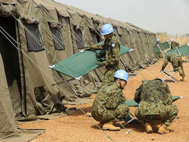 Unknown assailants fired rockets at a UN peacekeeping base in northern Mali, killing at least three people.
