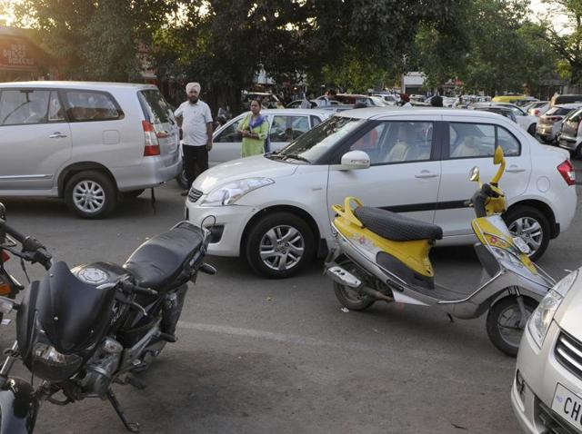 Vehicles parked haphazardly in city's parking lots add to the chaos.