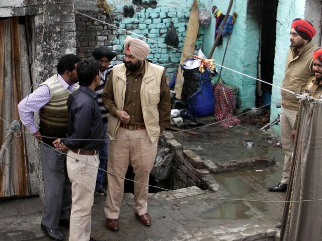 Policemen carrying out preliminary investigation at Sherpur Chowk  in Ludhiana on Saturday.