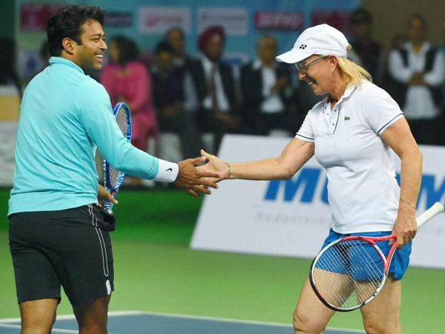 Martina Navratilova, Leander Paes and Mahesh Bhupathi and Sania Mirza shake hands at the net after their mixed doubles exhibition match at the DLTA complex in New Delhi on November 27, 2015.