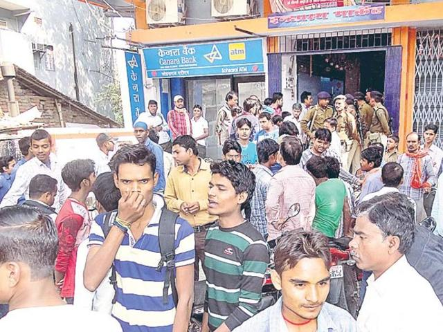 A crowd outside the bank after the robbery, at Sohsarai in Nalanda district on Friday.