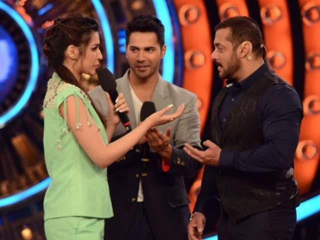 Actors Varun Dhawan and Kriti Sanon with Salman Khan on Bigg Boss 9 show.