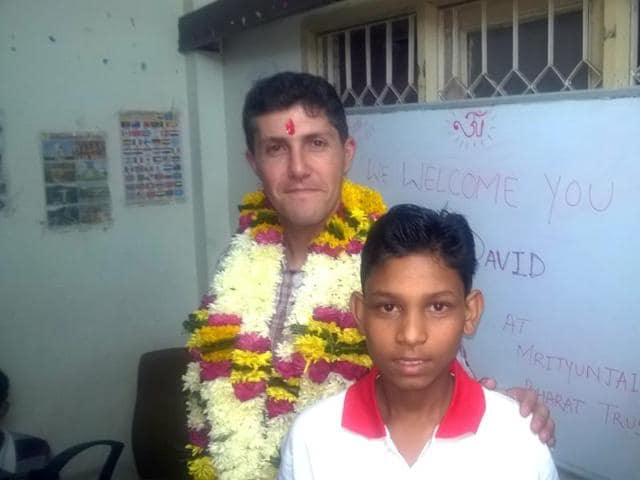 David Liaño Gonzalez with a child in Indore on Saturday.
