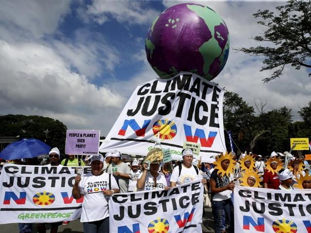 Protesters attend a climate change march on a highway in Manila on November 28, 2015. Thousands turned out for climate change marches in Manila and Brisbane as part of a weekend of action across the globe to demand results from next week's historic Paris summit.
