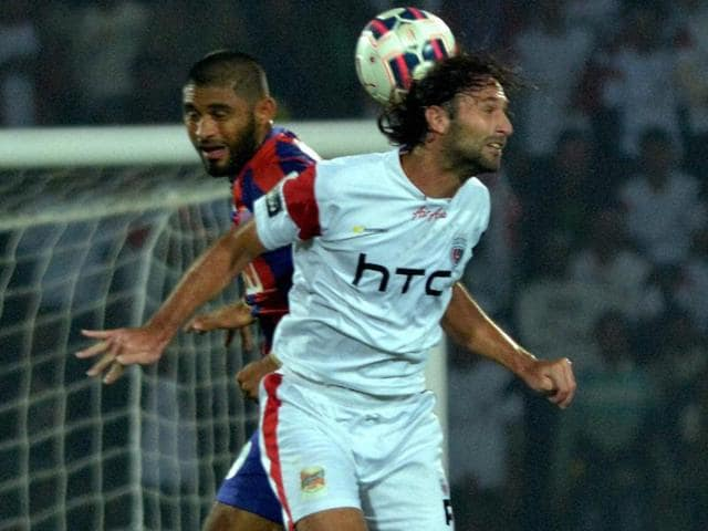 Players of North East United FC (white) and Delhi FC during the ISL match at Indira Gandhi Athletic Stadium in Guwahati on November 28.