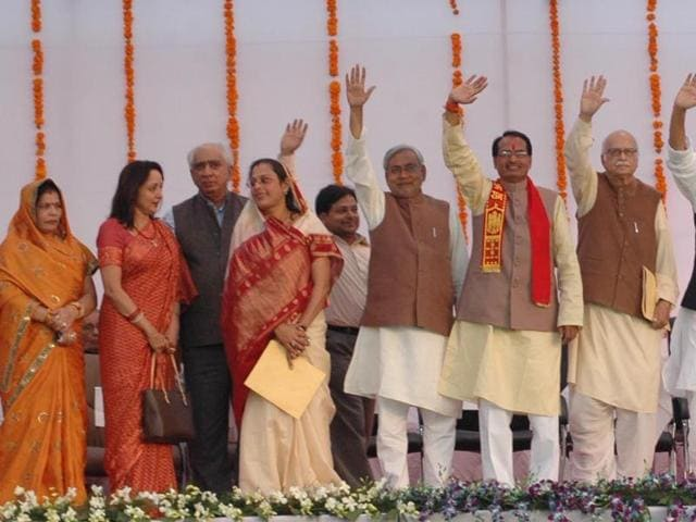 Chief minister Shivraj Singh Chouhan along with senior party leader waving after taking oath on December 12, 2008.