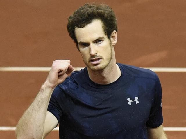 Britain's Andy Murray celebrates after his team won the doubles tennis match on the second day of the Davis Cup final on November 28, 2015.