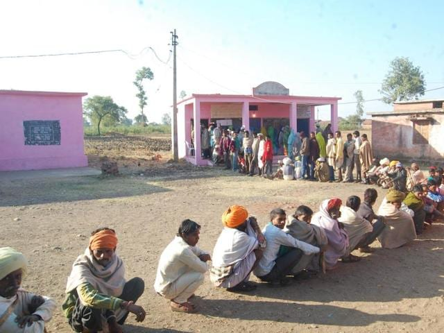 Voters line up at a polling station in a Gujarat village.