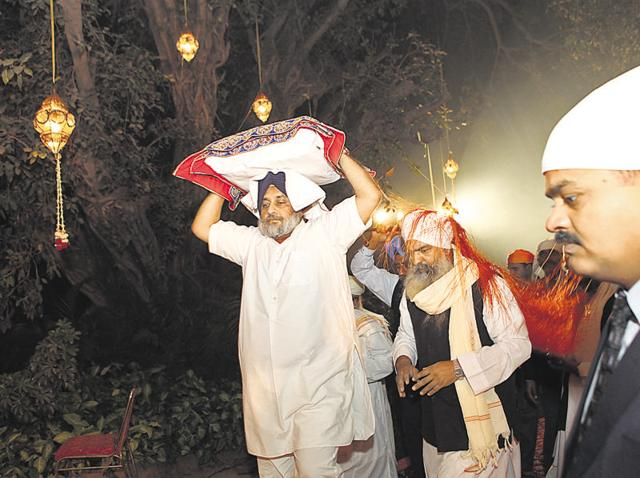 Punjab deputy chief minister Sukhbir Singh Badal carrying the holy book during the Gurpurb celebrations at the official residence of his wife and Union minister for food processing Harsimrat Kaur Badal in Delhi recently; and Harsimrat with Union minister for minority affairs Najma Heptulla (centre) and Union minister of state for commerce Nirmal Sitharaman (right).