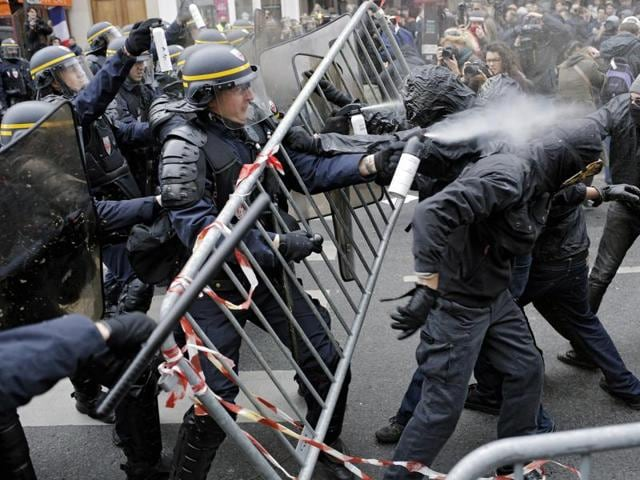 Policemen clash with activists during a protest ahead of the 2015 Paris Climate Conference that opens on Monday.