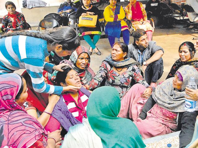 Relatives of the woman who died at the CMCH mourning outside the hospital in Ludhiana on Monday.