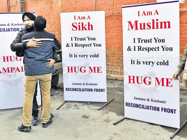 People hug each other during the 'Hug campaign' to promote brotherhood, interfaith dialogue, tolerance and build bridges between people of different communities within Jammu and Kashmir.