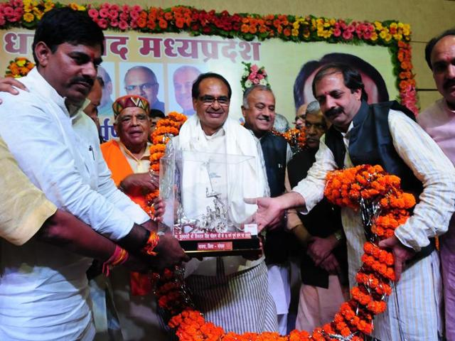 BJP leaders felicitate chief minister Shivraj Singh Chouhan during a programme organised to mark his 10 years in office, in Bhopal on Sunday.