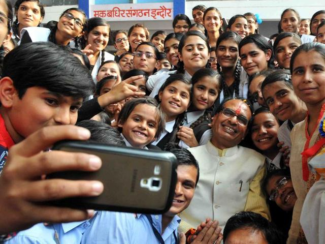Indore Deaf Bilingual Academy children click selfie with the chief minister, in Indore on Sunday.