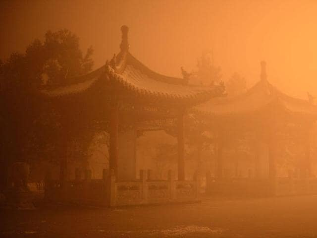 This picture taken on November 29, 2015 shows pagodas on a polluted day in Hohhot, north China's Inner Mongolia region.