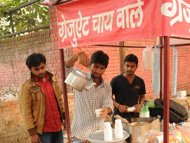 (From left) Govind Tripathi, his friend Rajendra Singh and brother MadhavTripathi at the tea stall on Monday.