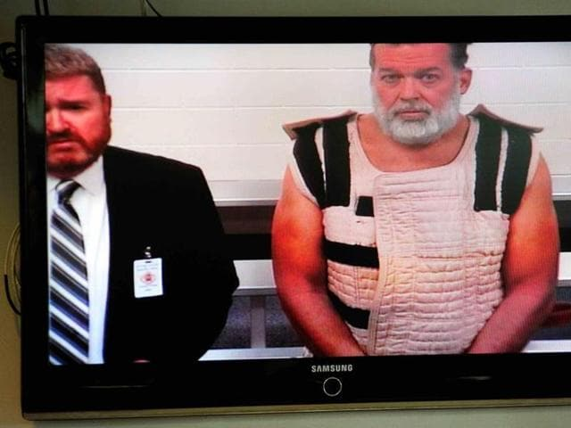 Accused Planned Parenthood gunman Robert Lewis Dear appears in court with public defender Dan King by video link from jail in Colorado Springs, Colorado.