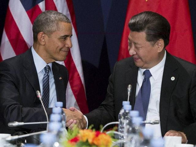 US President Barack Obama, left, shakes hands with Chinese President Xi Jinping during their meeting held on the sidelines of the COP21, United Nations Climate Change Conference in Le Bourget outside Paris on Monday.