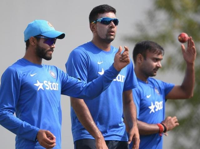 India's Ravindra Jadeja (L), Ravichandran Ashwin (C) and Amit Mishra wait their turn to bowl in the nets during a training session ahead of the third Test cricket match between India and South Africa at The Vidarbha Cricket Association Stadium in Nagpur on November 24, 2015.