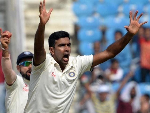 India's Ravichandran Ashwin celebrates the wicket of South African batsman AB de Villiers during the third day of the 3rd test match between India and South Africa in Nagpur on November 27,2015.