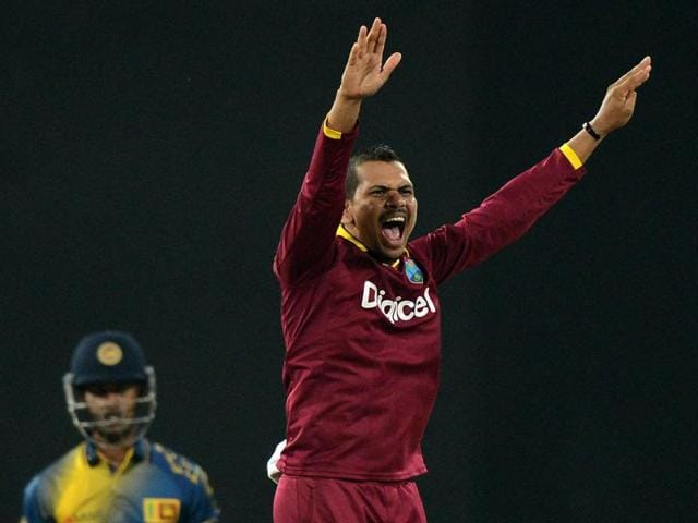 West Indies cricketer Sunil Narine (R)  appeals for a Leg Before Wicket decision against Sri Lankan cricketer Nuwan Kulasekara (L) during the second and final T20 International cricket match between Sri Lanka and the West Indies at the R Premadasa Stadium in Colombo on November 11, 2015.