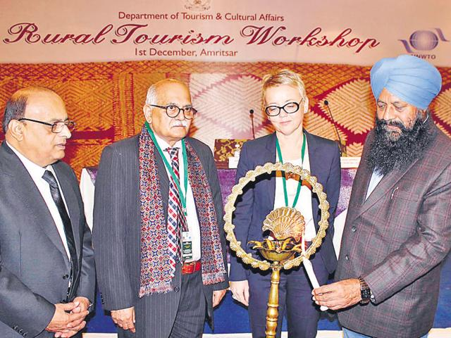 Punjab tourism minister Sohan Singh Thandal (right), Anne Maria Makela (second right) UNWTO international marketing consultant , SK Misra chairman  of Indian trust for Rural Heritage and Development and Dr Harsh Varma (extreme left) during rural tourism workshop in Amritsar on Tuesday.