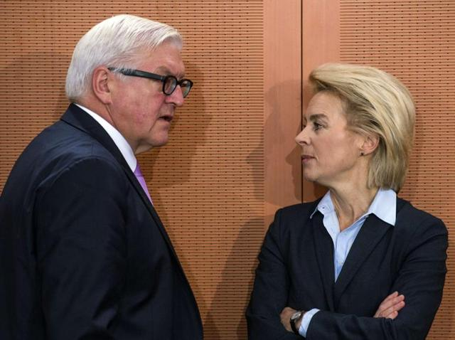 German defence minister Ursula von der Leyen (R) chats with foreign minister Frank-Walter Steinmeier. The German cabinet has approved plans to commit up to 1,200 soldiers to support the international coalition fighting against the Islamic State group in Syria.