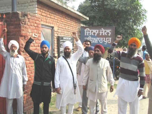 Sikh preacher Baljit Singh Daduwal's supporters staging a protest outside the district jail in Hoshiarpur on Tuesday.