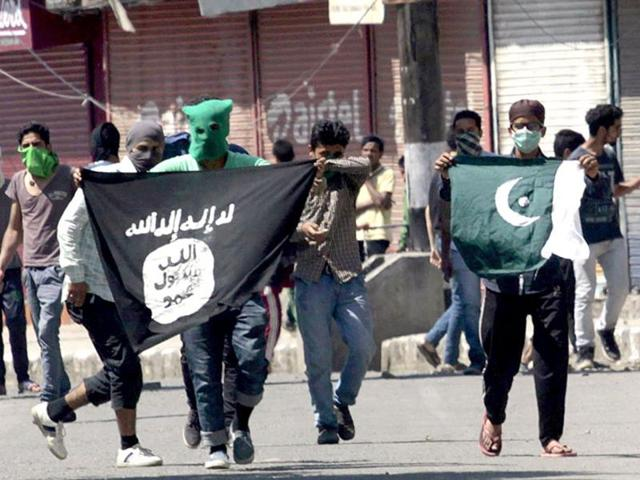 File photo of Kashmiri protesters displaying flags of the IS and Pakistan flag during a protest against the alleged desecration of Jamia Masjid by police in Srinagar, Jammu and Kashmir.