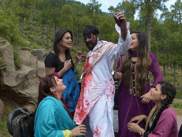 Pakistani actor Shahid Khan takes part in the filming of a scene with other actors during the shooting of Pashto film Ma Chera Gharib Sara (Don't Pester the Poor) in Murree, Islamabad.