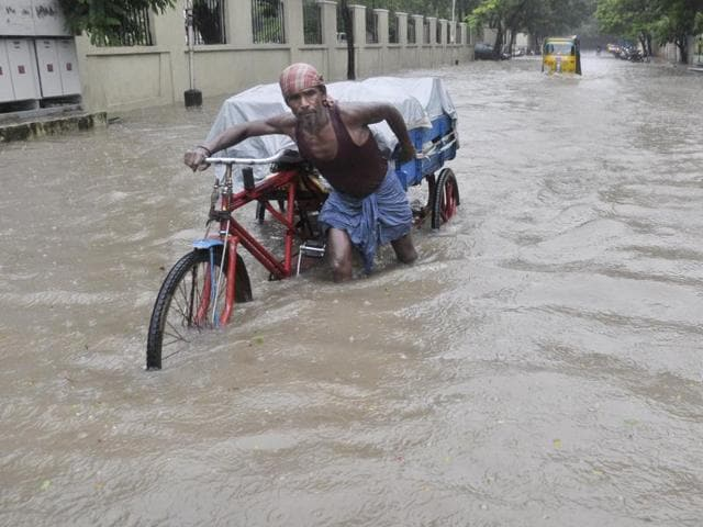 Normal life was thrown out of gear as heavy rains battered Chennai and north Tamil Nadu, with the Met office predicting more of the same in the region over the next three days. (HT Photo)