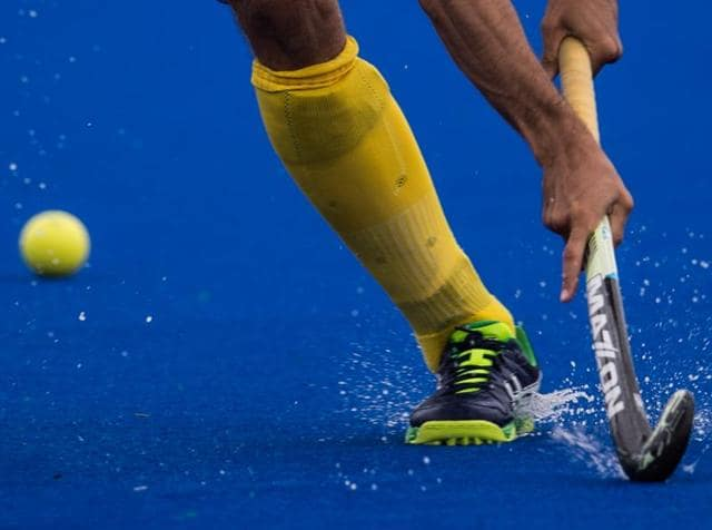 A Brazilian player takes part in the Rio 2016 Olympic Games hockey on grass test event against Mexico in Rio de Janeiro, Brazil on November 25, 2015.