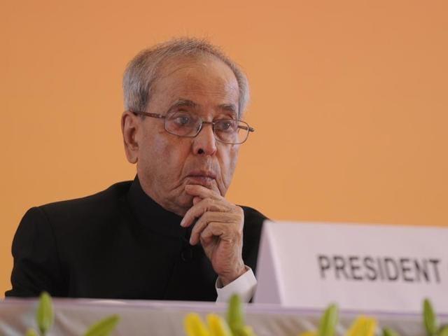 President Pranab Mukherjee lighting a lamp to inaugurate Amul's Feed Manufacturing Plant at Kapadwanj Tuluka, in Kheda.