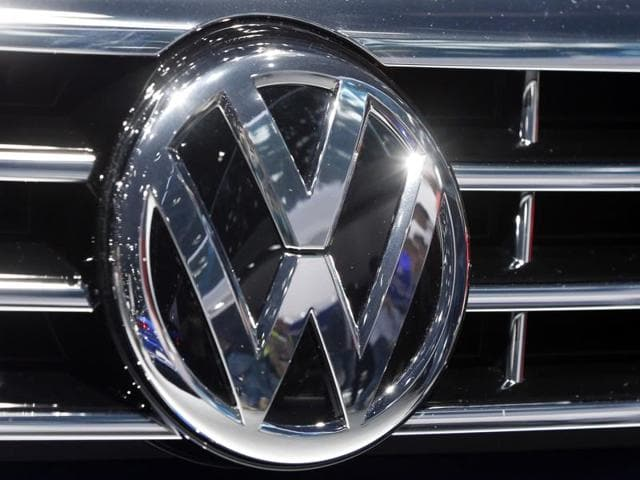 The logo of Volkswagen is displayed on a car.