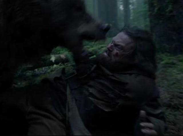 The bear in question and Leonardo DiCaprio.