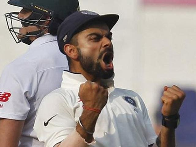 India's captain Virat Kohli celebrates after their win over South Africa on the third day of their third test cricket match in Nagpur on November 27, 2015.