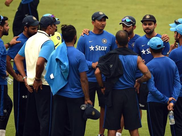 India's captain Virat Kohli talks with teammates and support staff during a training session ahead of the fourth Test cricket match between India and South Africa at The Feroz Shah Kotla Stadium on December 1, 2015.
