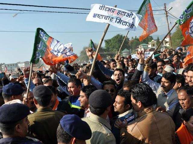 BJP activists try to cross barricades at the Vidhan Sabha during the 'Virbhadra Hatao Pradesh Bachao' protest rally at Zorawar stadium near Dharamsala on Wednesday.