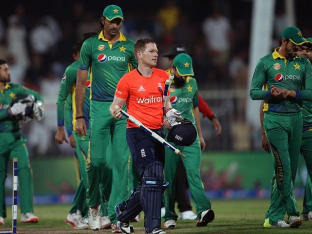 England's batsman Eoin Morgan takes the wickets after his side won the third T20 against Pakistan at the Sharjah Cricket Stadium in Sharjah on November 30, 2015.