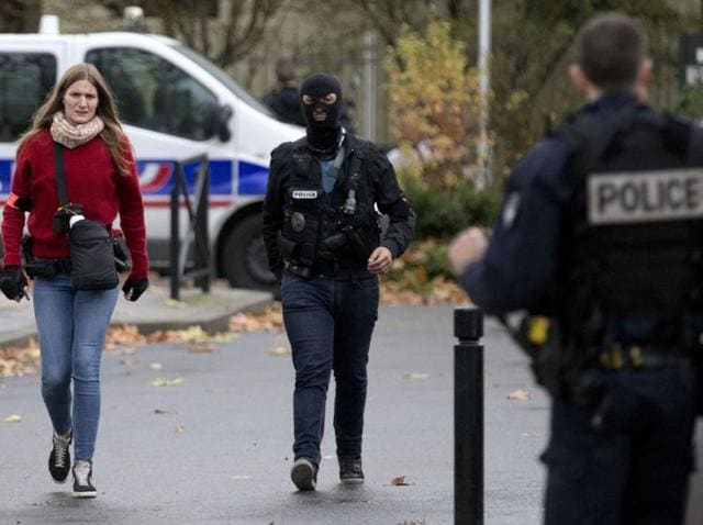 France, which declared a state of emergency after the Islamist attacks on Paris, has so far raided 2,235 homes and buildings, taken 232 people into custody and confiscated 334 weapons, 34 of then war-grade.