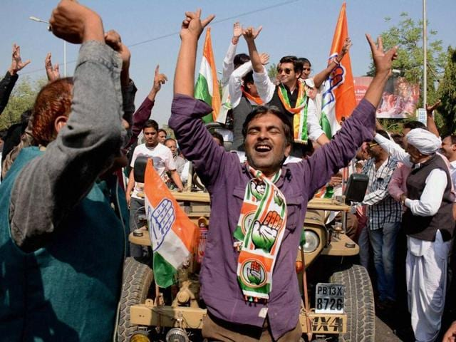 Congress workers celebrate  after their candidate's victory in Municipal elections in Ahmedabad.