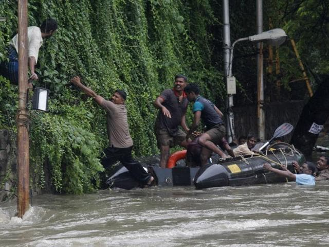 Patients and their care-takers being shifted to safe place from a flooded hospital after heavy rains in Chennai on Tuesday.