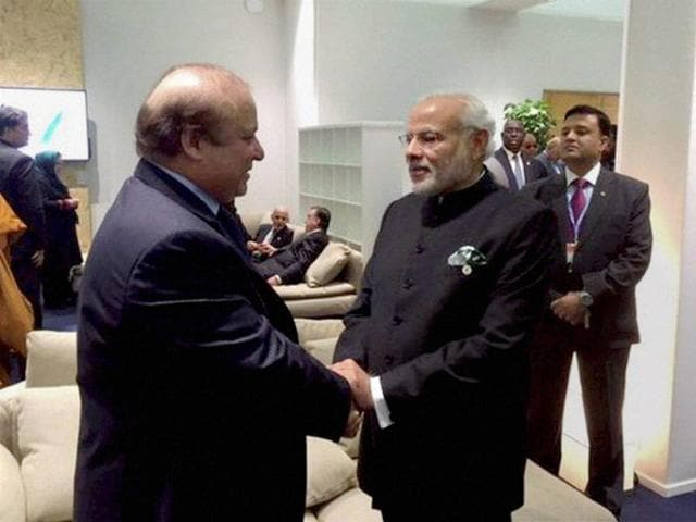 Prime Minister Narendra Modi with his Pakistani counterpart Nawaz Sharif in Paris on the sidelines of CoP 21 summit on climate change.
