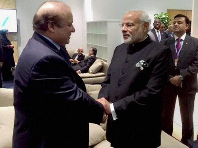 Prime Minister Narendra Modi shakes hands with his Pakistani counterpart Nawaz Sharif in Paris on the sidelines of CoP 21 summit on climate change.