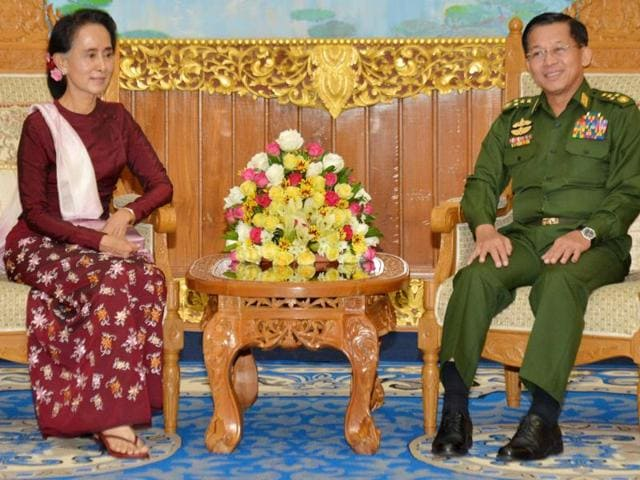 Myanmar pro-democracy leader Aung San Suu Kyi talks with Myanmar military commander-in-chief Senior General Min Aung Hlaing during their meeting at the military headquarters in Naypyidaw.