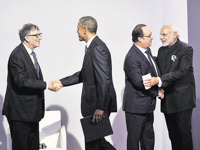 From left: Microsoft founcer Bill Gates, US President Barack Obama, French President Francois Hollande and Prime Minister Narendra Modi at the climate change summit in Paris.