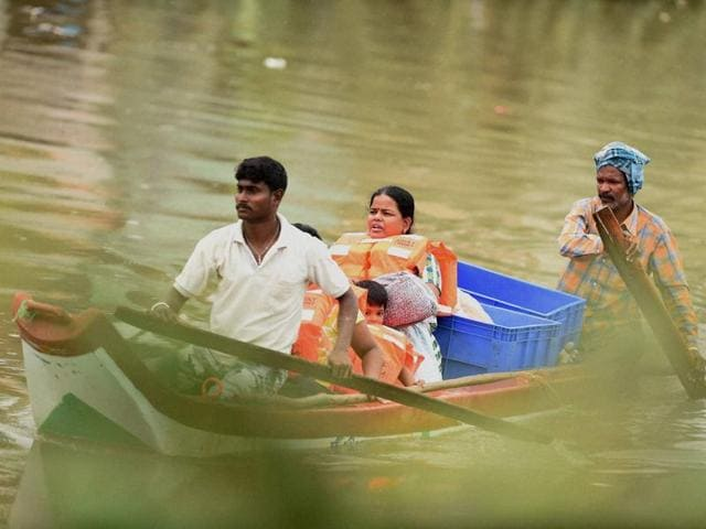 People in Chennai have been struggling to cope with the strong deluge, which has flooded large parts of the city.
