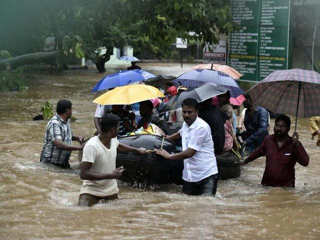 Patients and their care-takers are being shifted to safer places from a flooded hospital in Chennai.